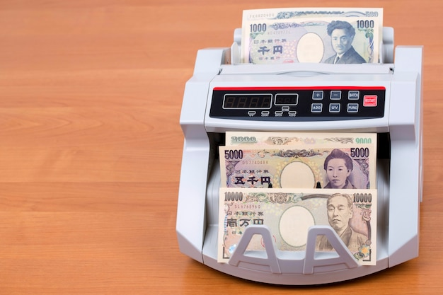 Japanese yen in a counting machine