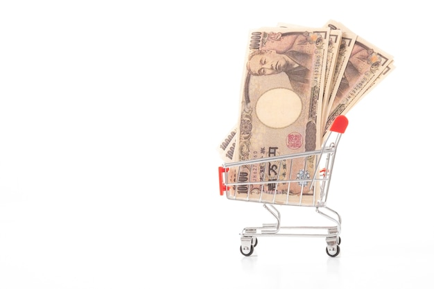 Japanese yen, jpy in small shopping trolley on white background. finance concept.