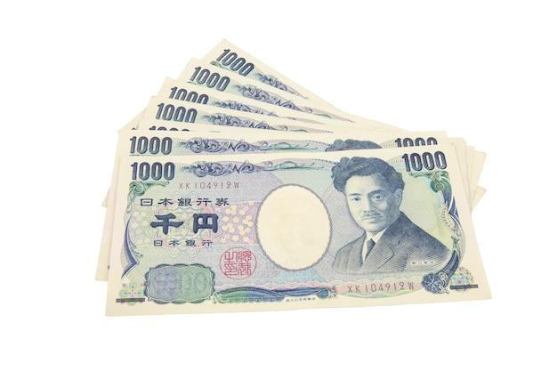 日本円ノート。白い背景の日本の通貨