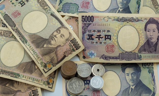 Japanese yen notes and japanese yen coins for money concept background