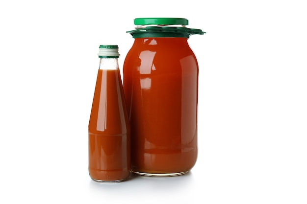 Jar and bottle of carrot juice isolated on white