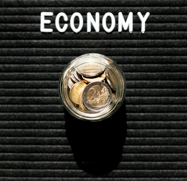 Jar of coins and economy word