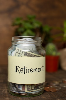 Jar filled with money and retirement label