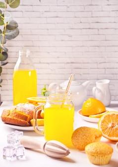 Jar of fresh lemonade. sliced lemon on background.