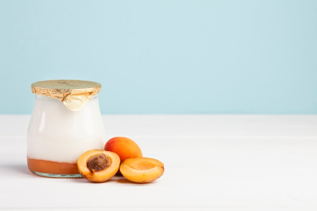 Jar of fresh milk and apricot fruit