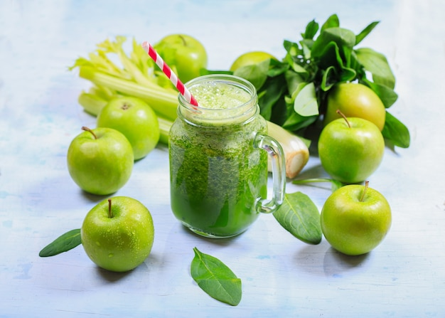 Jar of green smoothie with apple, celery and spinach