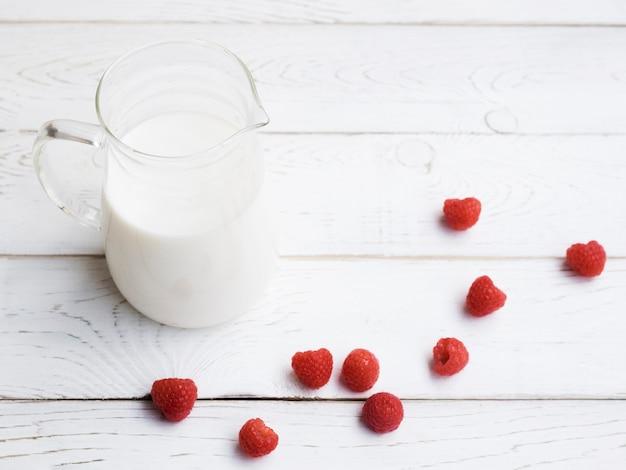 Jar of milk and raspberries