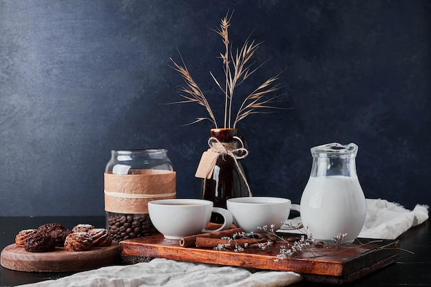 Jar of milk with coffee beans and chocolate pralines.