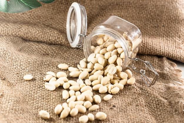 Jar of peanuts on gunny sack