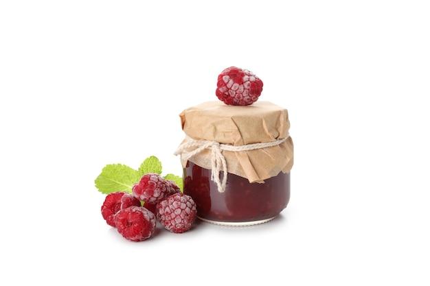 Jar of raspberry jam isolated on white background