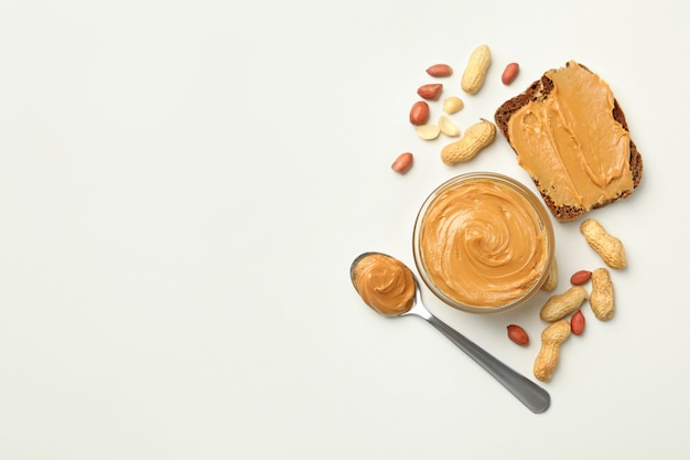 Jar spoon and sandwich with peanut butter isolated