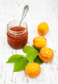 Jar with apricot jam on a tble