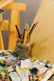 Jar with brushes on palette