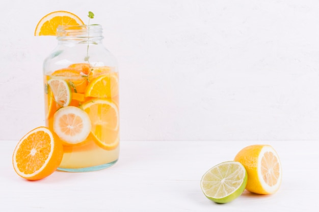 Jar with citrus beverage