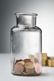 Jar with coins savings