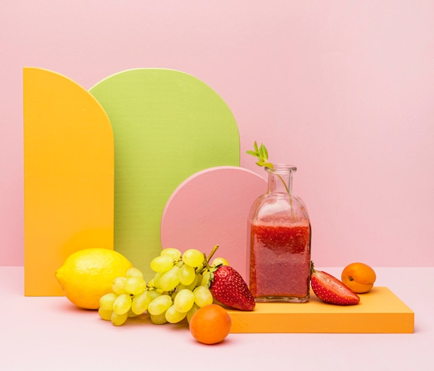 Jar with fresh fruits smoothie