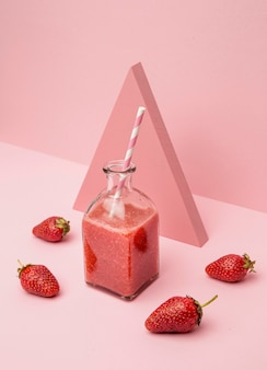 Jar with fresh smoothie of strawberry