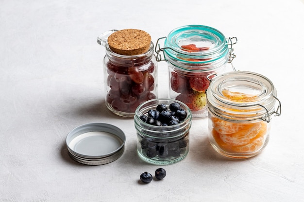 Jar with fruits arrangement high angle