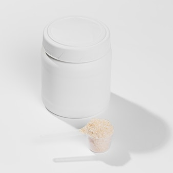Jar with gym supplements powder scoop