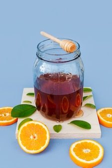 Jar with homemade honey and oranges