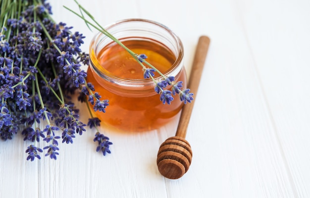 Jar with honey and fresh lavender flowers