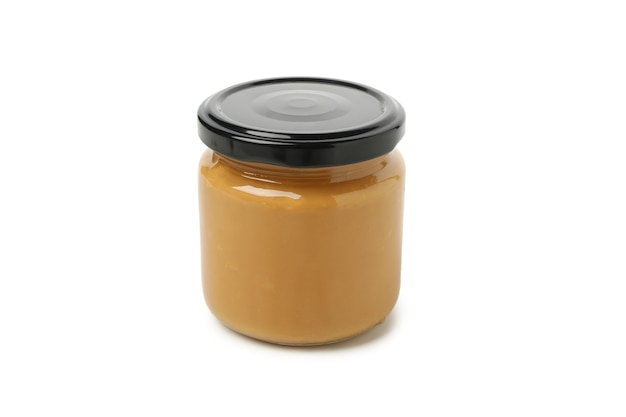 Jar with peanut butter isolated on white background