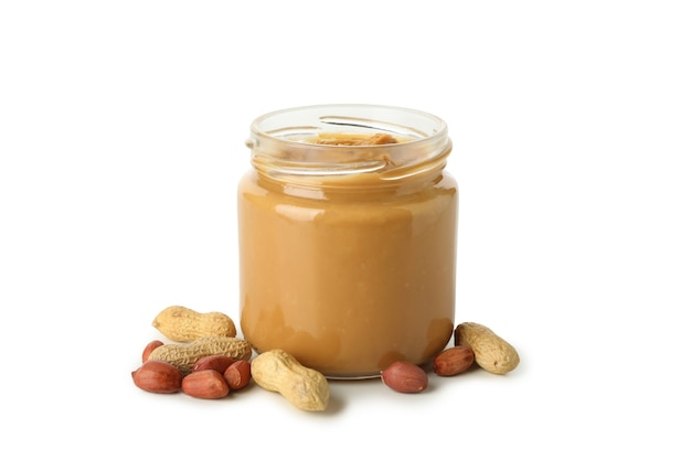 Jar with peanut butter and peanut isolated on white background