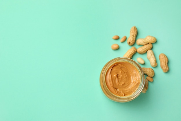 Jar with peanut butter and peanut isolated