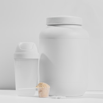 Jar with powder supplements for gym