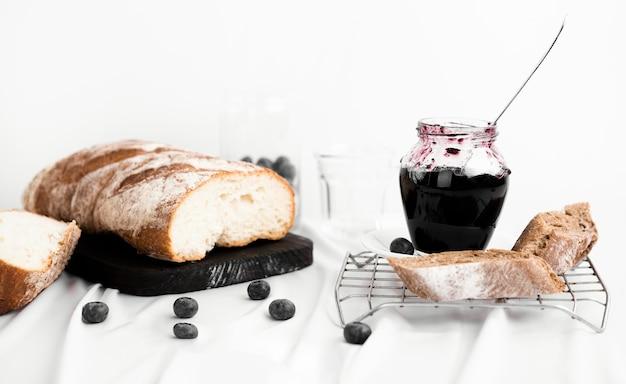 Jar with tasty blueberry jam