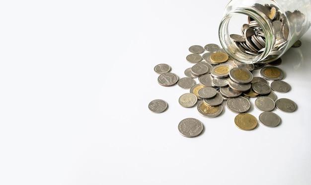 Jar with thai coins on table
