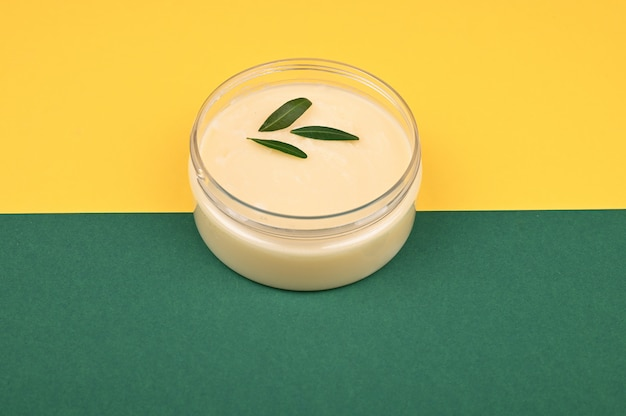 Jar with vegetable cream. view from above. place for inscription