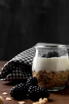 Jar with yougurt and granola and berry