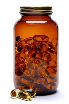 薬瓶は、白い背景で隔離のカプセルでjarファイルできます。