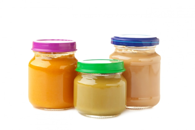 Jars of baby puree isolated on white background.