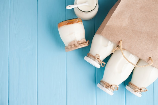 Jars and bottles of milk in paper bag
