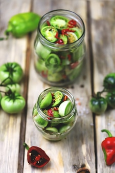 Jars of fermented green tomatoes.