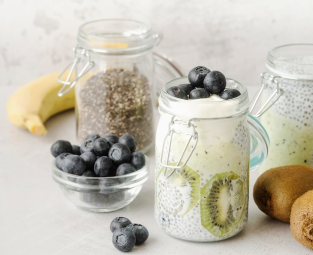 Jars filled with milk and fruit