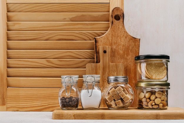 Jars full of food ingredients and wooden background