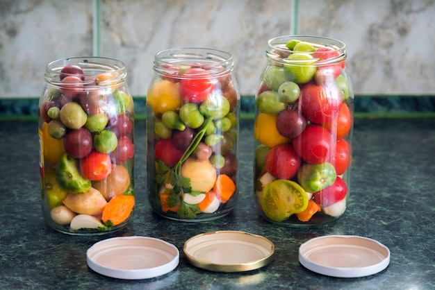 Jars of pickled vegetables. traditional marinated food.