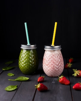 Jars of spinach and strawberry smoothie