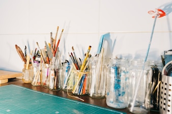 Jars with brushes and spatulas
