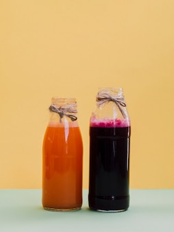 Jars with fresh beetroot and carrot juice