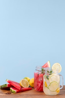 Jars with fresh drinks on table