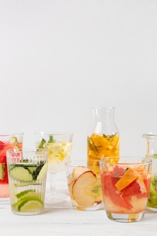 Jars with fresh fruits drinks