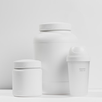 Jars with gym supplements and bottle