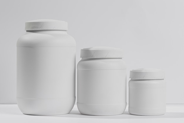 Jars withpowder supplements for gym