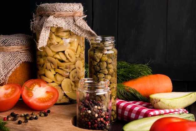 Jars with preserved food assortment