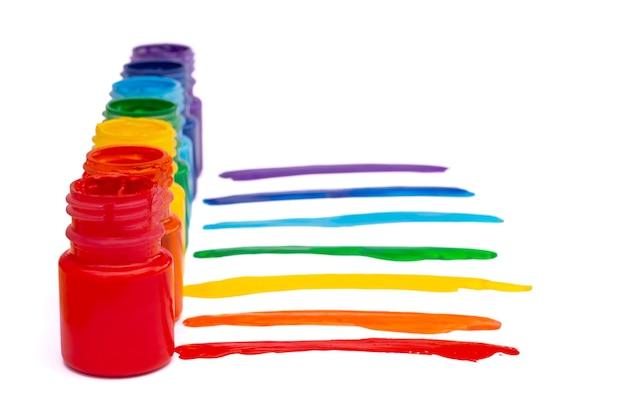 白い背景で隔離の虹色の瓶。