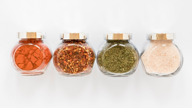 Jars with spices arrangement above view
